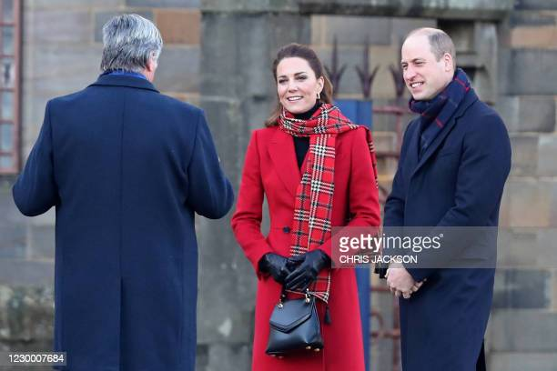 Britain's Prince William, Duke of Cambridge , and Britain's Catherine, Duchess of Cambridge arrive at Cardiff Castle in Cardiff in south Wales on...