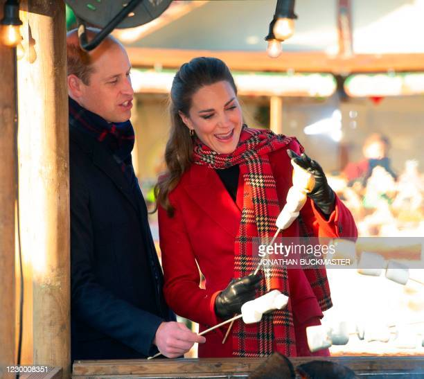 Britain's Prince William, Duke of Cambridge and Britain's Catherine, Duchess of Cambridge attend a 'Toast Your Own Marshmallow' stall during a visit...