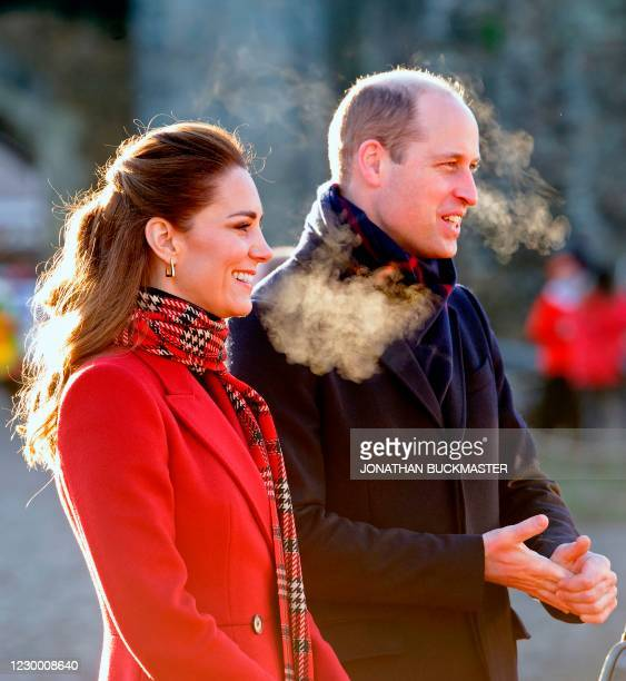 Britain's Prince William, Duke of Cambridge , and Britain's Catherine, Duchess of Cambridge smile during a visit to Cardiff Castle in Cardiff in...
