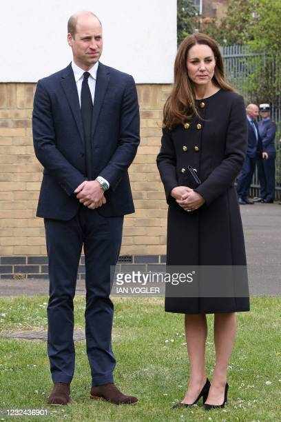 Britain's Prince William, Duke of Cambridge, and Britain's Catherine, Duchess of Cambridge, wearing black as a mark of respect following the death of...