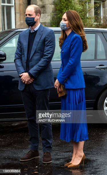 Britain's Prince William, Duke of Cambridge and Britain's Catherine, Duchess of Cambridge, wear protective face coverings to combat the spread of the...