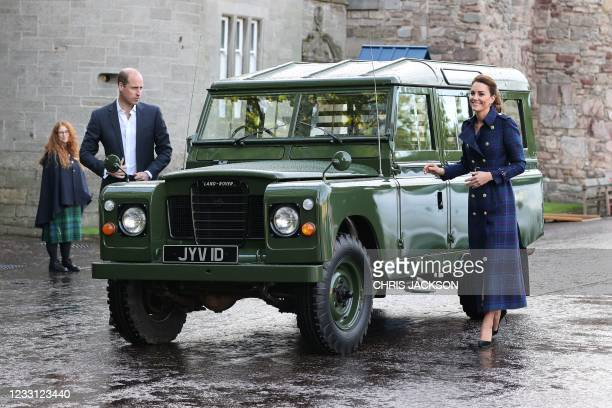 Britain's Prince William, Duke of Cambridge and Britain's Catherine, Duchess of Cambridge arrive in a Land Rover Defender that previously belonged to...