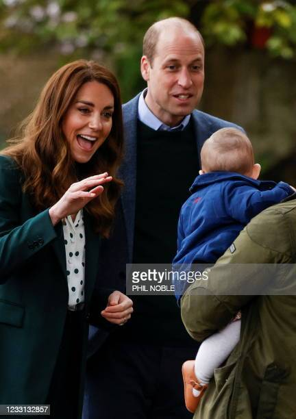 Britain's Prince William, Duke of Cambridge and Britain's Catherine, Duchess of Cambridge meet Penelope Stewart during their visit to Starbank Park...