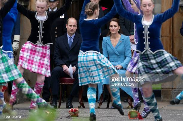 Britain's Prince William, Duke of Cambridge and Britain's Catherine, Duchess of Cambridge watch Highland dancers perform during a Beating Retreat by...