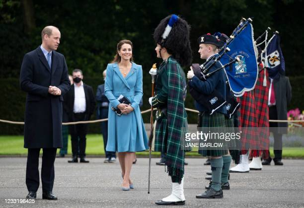 Britain's Prince William, Duke of Cambridge and Britain's Catherine, Duchess of Cambridge attend a Beating Retreat by The Massed Pipes and Drums of...