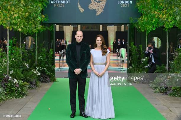 Britain's Prince William, Duke of Cambridge, and Britain's Catherine, Duchess of Cambridge, arrive on the green carpet to attend the inaugural...