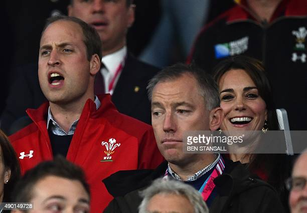 Britain's Prince William , Duke of Cambridge, and Britain's Catherine, Duchess of Cambridge, attend during a Pool A match of the 2015 Rugby World Cup...