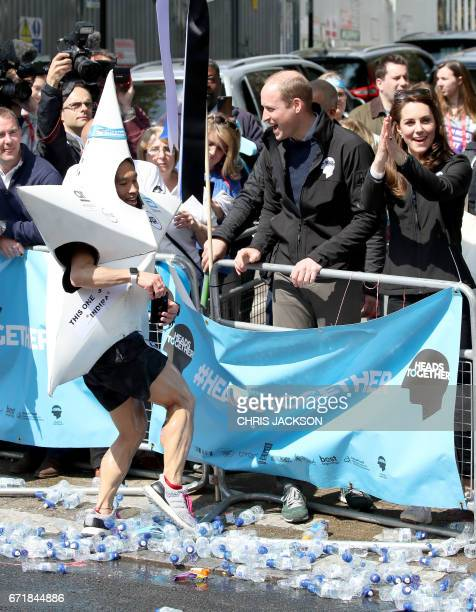Britain's Prince William Duke of Cambridge and Britain's Catherine Duchess of Cambridge hand out water to runners during the 2017 London Marathon in...