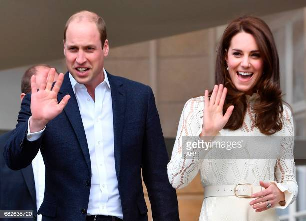 Britain's Prince William Duke of Cambridge and Britain's Catherine Duchess of Cambridge wave as they host a Special Garden Party at Buckingham Palace...