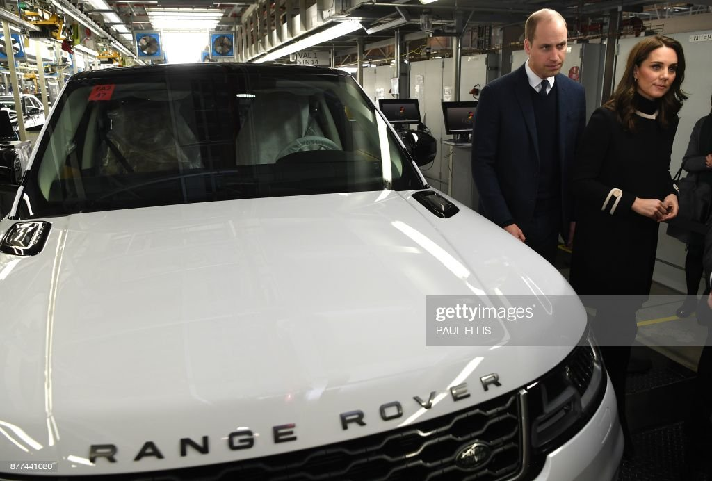 Britain's Prince William, Duke of Cambridge, and Britain's Catherine, Duchess of Cambridge, tour the Range Rover production line during their visit to Jaguar Land Rover's Solihull manufacturing plant in Birmingham, central England on November 22, 2017. The Duke and Duchess of Cambridge visited Birmingham for a day of engagements on November 22 which saw them visit Jaguar Land Rover's Solihull site, Aston Villa Football Club and Acme Whistles, the creator of the first police whistle and the original Acme Thunderer. / AFP PHOTO / POOL AND AFP PHOTO / Paul ELLIS