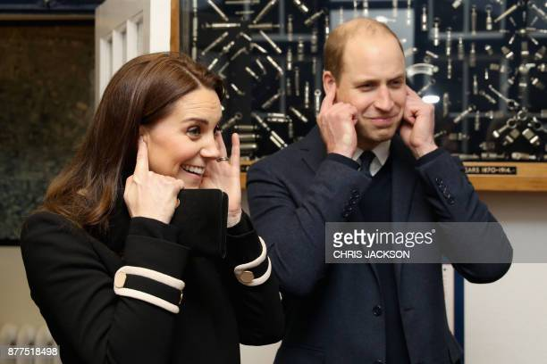 Britain's Prince William Duke of Cambridge and Britain's Catherine Duchess of Cambridge react to the sound of a whistle during their visit to Acme...