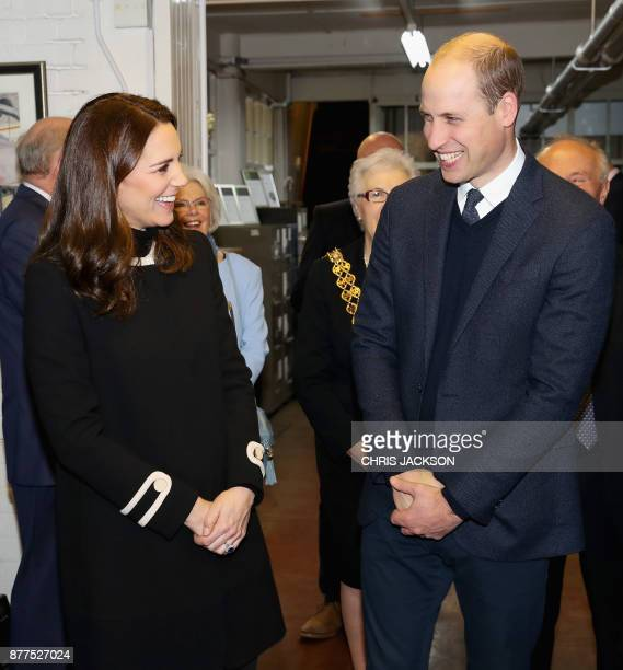 Britain's Prince William Duke of Cambridge and Britain's Catherine Duchess of Cambridge gesture during their visit to Acme Whistles the creator of...