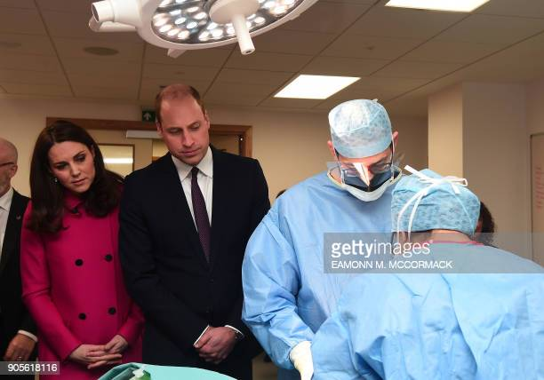 Britain's Prince William Duke of Cambridge and Britain's Catherine Duchess of Cambridge watch an operating theatre procedure being practiced as they...