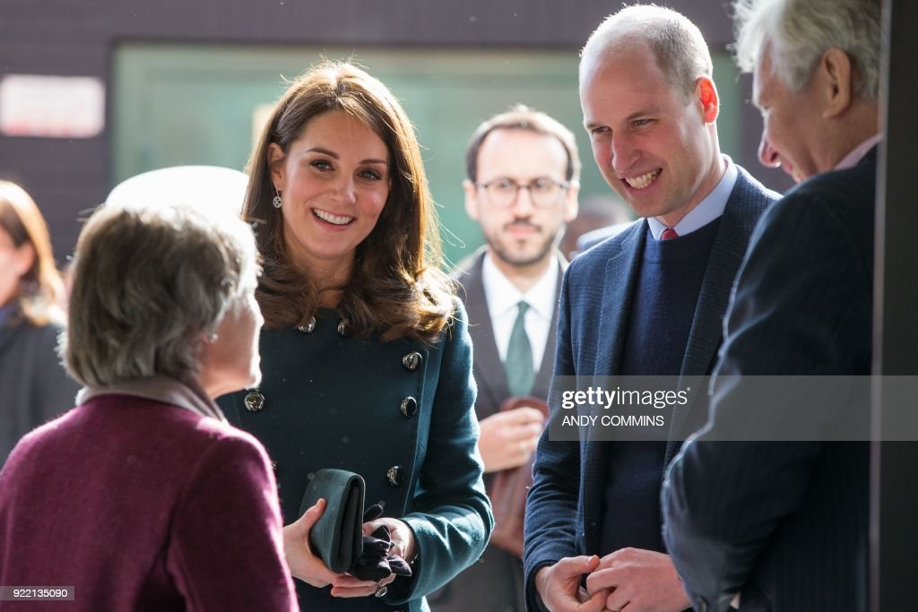 Britain's Prince William, Duke of Cambridge (R), and Britain's Catherine, Duchess of Cambridge (L), visit The Fire Station, an iconic building recently converted into a music and arts hub, in Sunderland, northeast England, on February 21, 2018. The Duke and Duchess of Cambridge visited Sunderland to learn about the city's arts scene and engineering talent. / AFP PHOTO / POOL / Andy COMMINS