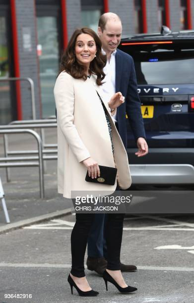 Britain's Prince William Duke of Cambridge and Britain's Catherine Duchess of Cambridge gesture on their arrival to undertake engagements celebrating...