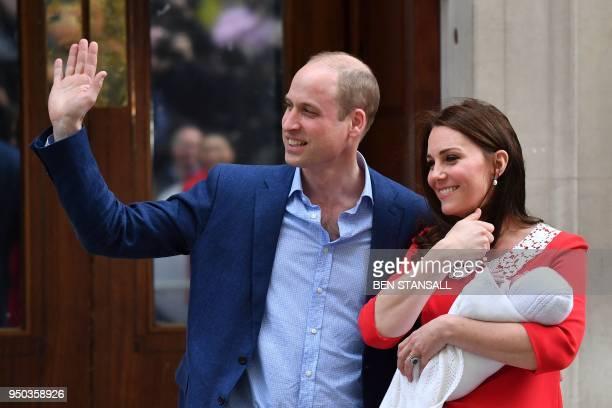 Britain's Prince William Duke of Cambridge and Britain's Catherine Duchess of Cambridge aka Kate Middleton show their newlyborn son their third child...