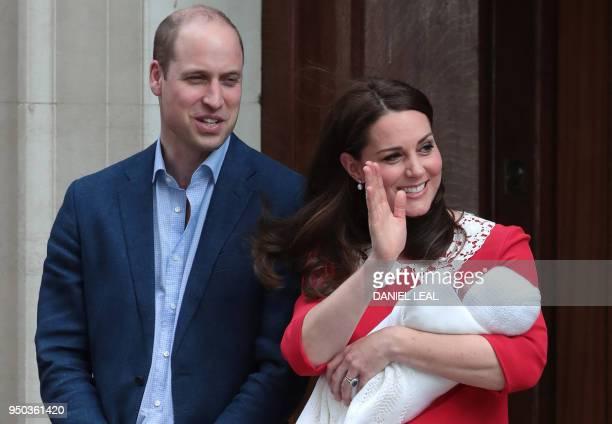 Britain's Prince William, Duke of Cambridge and Britain's Catherine, Duchess of Cambridge aka Kate Middleton show their newly-born son, their third...