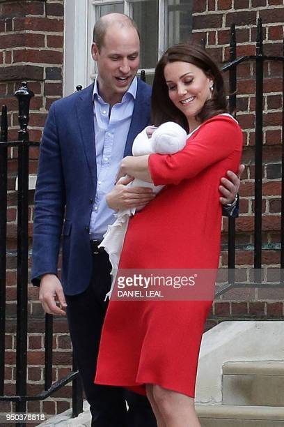 TOPSHOT Britain's Prince William Duke of Cambridge and Britain's Catherine Duchess of Cambridge show their newlyborn son their third child to the...