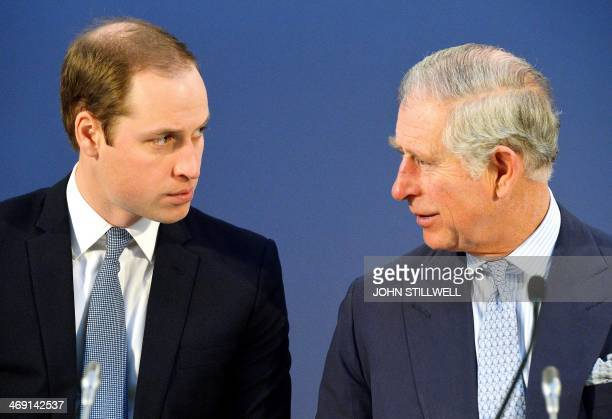 Britain's Prince William Duke of Cambridge and Britain's Prince Charles Prince of Wales talk during the Illegal Wildlife Trade Conference at...