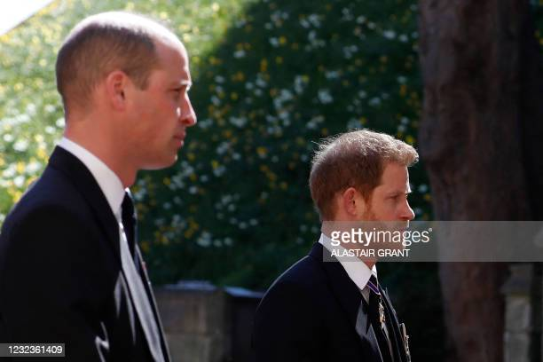 Britain's Prince William, Duke of Cambridge and Britain's Prince Harry, Duke of Sussex follow the coffin during the ceremonial funeral procession of...