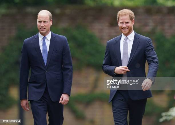 Britain's Prince William, Duke of Cambridge and Britain's Prince Harry, Duke of Sussex arrive for the unveiling of a statue of their mother, Princess...