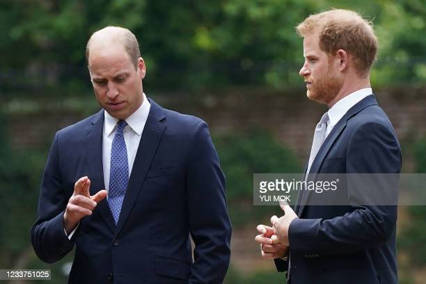 Britain's Prince William, Duke of Cambridge and Britain's Prince Harry, Duke of Sussex chat ahead ofthe unveiling of a statue of their mother,...