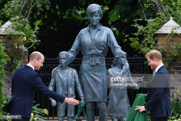 Britain's Prince William, Duke of Cambridge and Britain's Prince Harry, Duke of Sussex unveil a statue of their mother, Princess Diana at The Sunken...