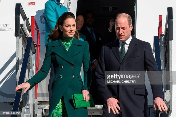 Britain's Prince William Duke of Cambridge and Catherine Duchess of Cambridge disembark as they arrive at Dublin International Airport in Dublin on...
