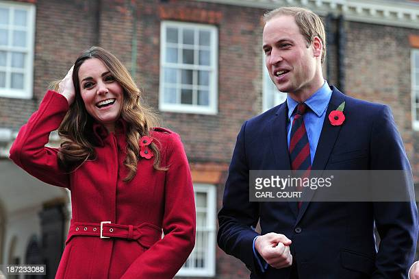 Britain's Prince William, Duke of Cambridge, and Catherine, Duchess of Cambridge, arrive to meet staff and volunteers from the Royal British Legions...