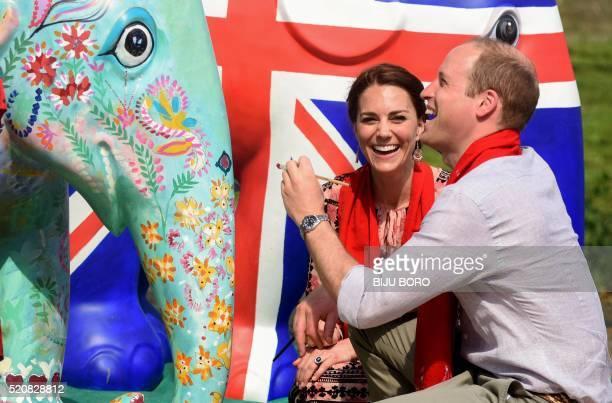 TOPSHOT Britain's Prince William Duke of Cambridge and Catherine Duchess of Cambridge paint an elephant statue at Kaziranga Discovery Park in Panbari...