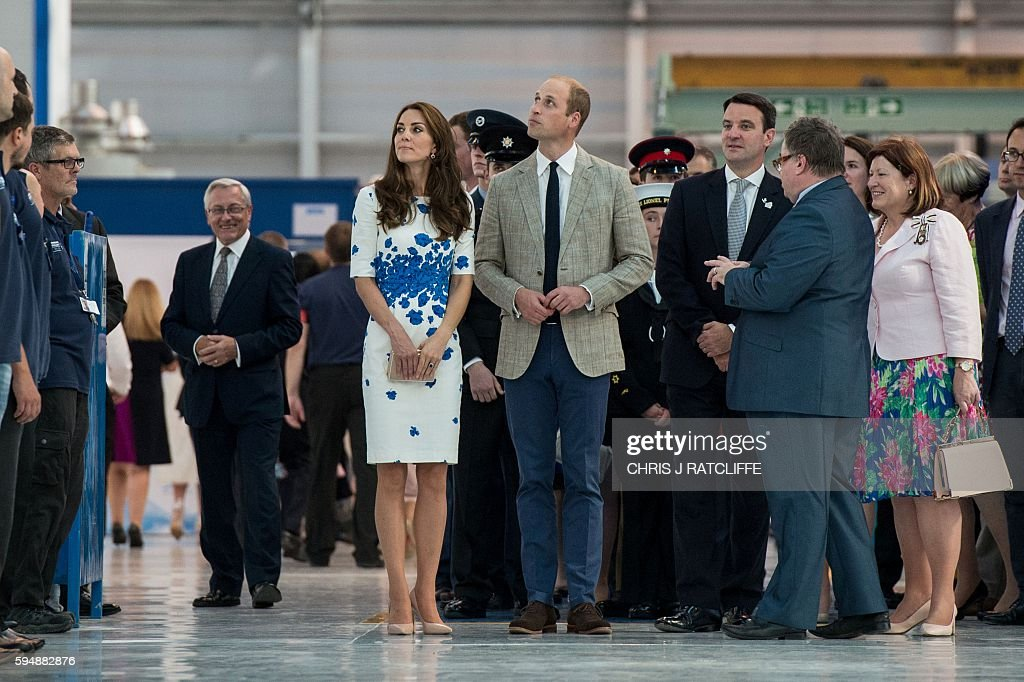 Britain's Prince William, Duke of Cambridge (R) and Catherine, Duchess of Cambridge (L) visit Hayward Tyler in Luton, north of London, on August 24, 2016, where they presented the company with The Queen's Award for Enterprise (International Trade) and opened their newly built Centre of Excellence. Hayward Tyler designs, manufactures, and services fluid-filled electric motors and pumps for high-pressure, high-temperature applications and environments across the global energy sector. / AFP / CHRIS