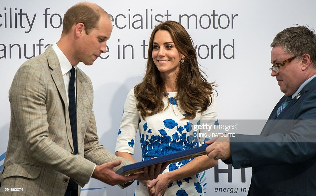 Britain's Prince William, Duke of Cambridge (L) and Catherine, Duchess of Cambridge (C) present the Queen's Award for Enterprise (International Trade) to General Manager of Hayward Tyler Luton, John Green (R), during their visit Hayward Tyler in Luton, north of London, on August 24, 2016. Hayward Tyler designs, manufactures, and services fluid-filled electric motors and pumps for high-pressure, high-temperature applications and environments across the global energy sector. / AFP / CHRIS