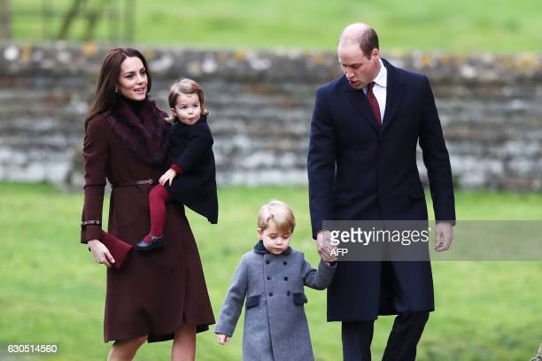TOPSHOT Britain's Prince William Duke of Cambridge and Catherine Duchess of Cambridge arrive with Prince George and Princess Charlotte to attend a...