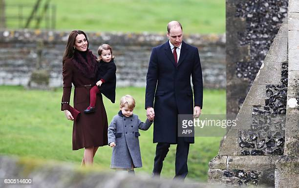 Britain's Prince William Duke of Cambridge and Catherine Duchess of Cambridge arrive with Prince George and Princess Charlotte to attend a Christmas...