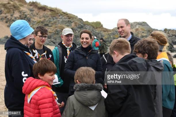 Britain's Prince William Duke of Cambridge and his wife Britain's Catherine Duchess of Cambridge explore the wildlife habitat on Newborough Beach...