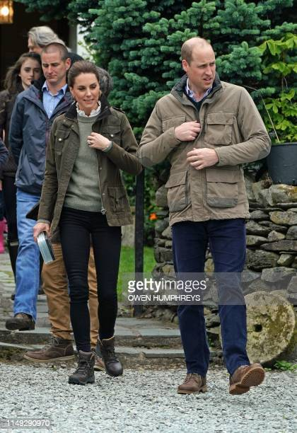 Britain's Prince William Duke of Cambridge and his wife Britain's Catherine Duchess of Cambridge visit Deepdale Hall Farm a traditional fell sheep...