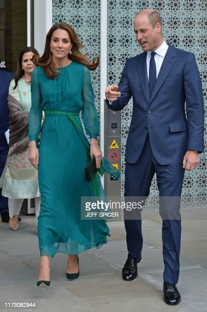 Britain's Prince William Duke of Cambridge and his wife Britain's Catherine Duchess of Cambridge leave after a visit to the Aga Khan Centre in London...