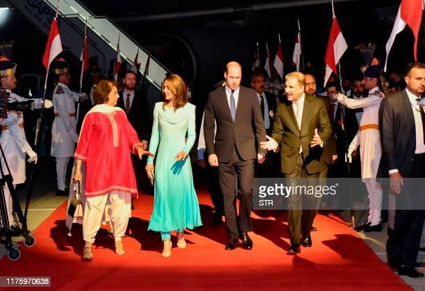 Britain's Prince William Duke of Cambridge and his wife Britain's Catherine Duchess of Cambridge are welcomed by Pakistan's Foreign Minister Shah...