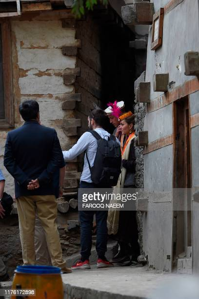 Britain's Prince William , Duke of Cambridge and his wife Britain's Catherine , Duchess of Cambridge meet with members of the Kalash tribe during...