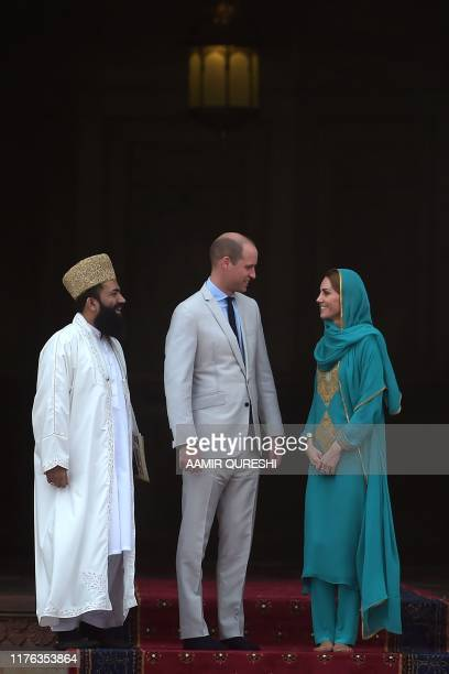 Britain's Prince William Duke of Cambridge and his wife Britain's Catherine Duchess of Cambridge visit with Grand Imam Abdul Khbeer Azad at the...