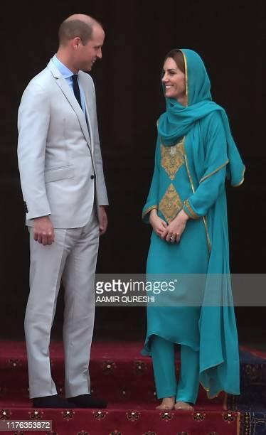 Britain's Prince William Duke of Cambridge and his wife Britain's Catherine Duchess of Cambridge visit the historical Badshahi mosque in Lahore on...