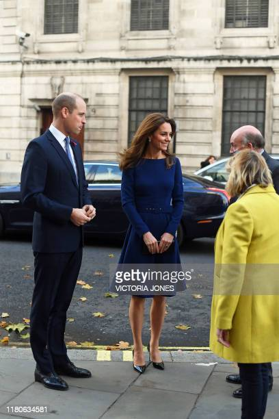 Britain's Prince William Duke of Cambridge and his wife Britain's Catherine Duchess of Cambridge arrive to attend the launch of the National...