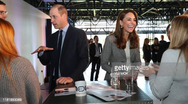 Britain's Prince William Duke of Cambridge and his wife Britain's Catherine Duchess of Cambridge attend the charity Shout's Crisis Volunteer...