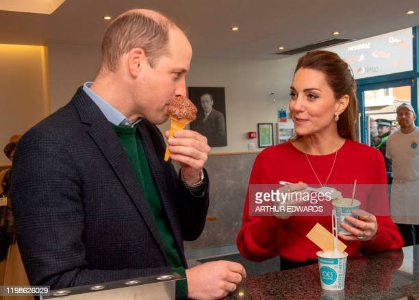 Britain's Prince William Duke of Cambridge and his wife Britain's Catherine Duchess of Cambridge taste ice creams at the counter during their visit...