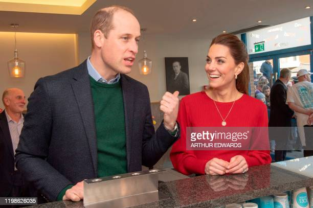 Britain's Prince William Duke of Cambridge and his wife Britain's Catherine Duchess of Cambridge chat at the counter during their visit to Joe's Ice...