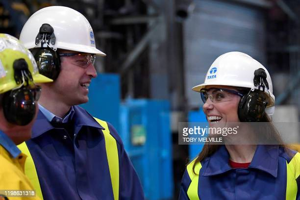 Britain's Prince William Duke of Cambridge and his wife Britain's Catherine Duchess of Cambridge wear hard hats and protective clothes during their...