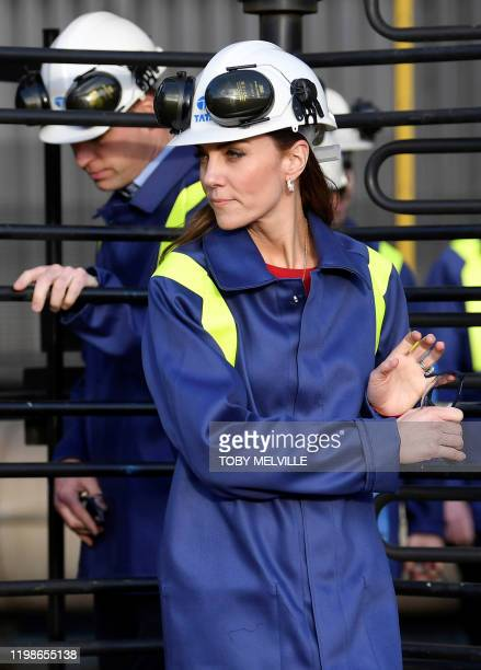 Britain's Prince William Duke of Cambridge and his wife Britain's Catherine Duchess of Cambridge wear hard hats and protective clothes as they...