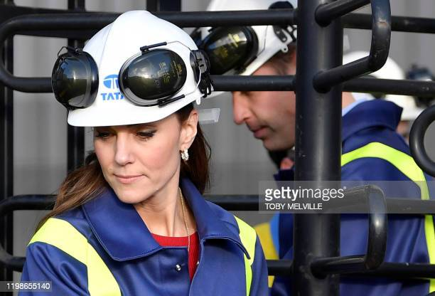 Britain's Prince William Duke of Cambridge and his wife Britain's Catherine Duchess of Cambridge wear hard hats and protective clothes as they pass...