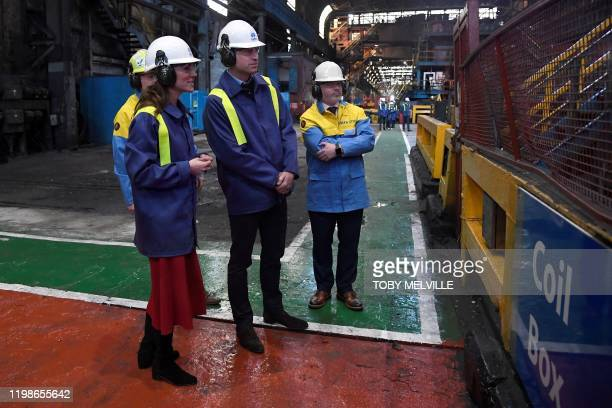 Britain's Prince William Duke of Cambridge and his wife Britain's Catherine Duchess of Cambridge wear hard hats and protective clothes as they talk...