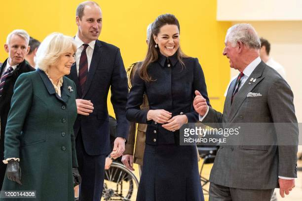 Britain's Prince William, Duke of Cambridge and his wife Britain's Catherine, Duchess of Cambridge talk with his father Britain's Prince Charles,...